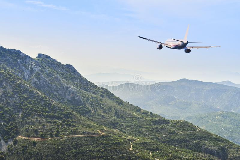 Airplane flying over the mountains. Travel concept.  stock images