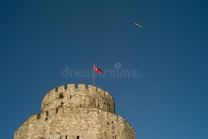 Airplane Flying over the Tower of a Castle. Airplane Flying over the Rumelian Castle, Istanbul, Turkey royalty free stock photos