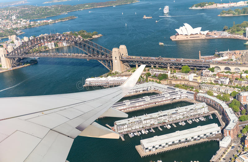 Airplane flying over Sydney. Tourism concept stock images