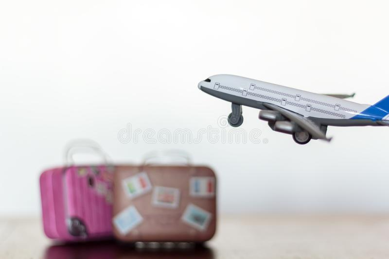 Airplane flying over travel luggage.  stock photos