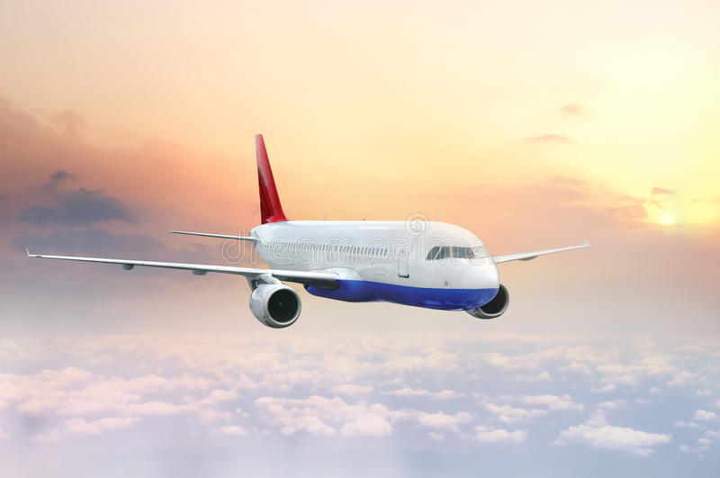 Airplane flying in the sky. Transport airplane flying in the sky at sunrise or sunset stock images