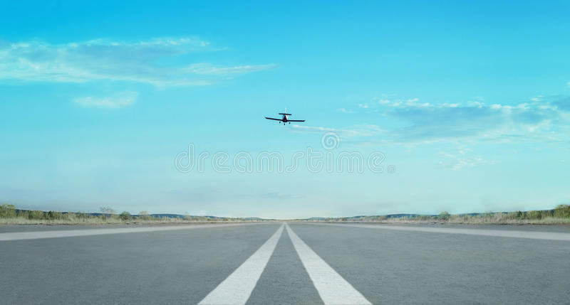 Airplane flying in the sky. Over runway royalty free stock photos
