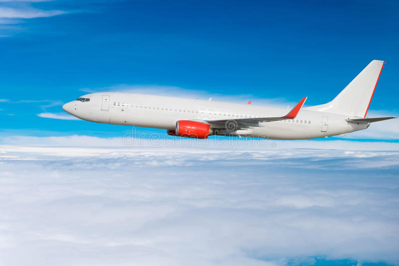 Airplane flying in the sky. White Airplane flying in the sky royalty free stock photo