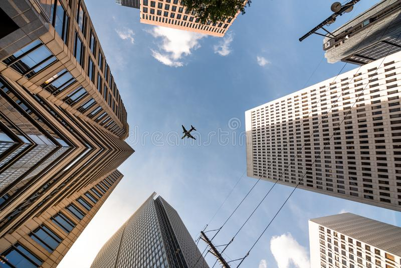 Airplane flying on top of Skycrapers in Midtown Atlanta royalty free stock photo