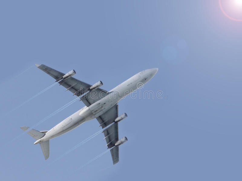 Airplane Flying Blue Sky Royalty Free Stock Photography