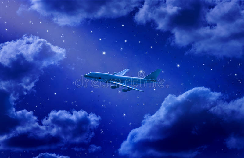 Airplane Flying Travel Night Sky. Air travel on an airplane flying through a night sky with stars and clouds in the background stock photos