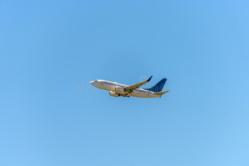 Airplane flying under the sky royalty free stock image