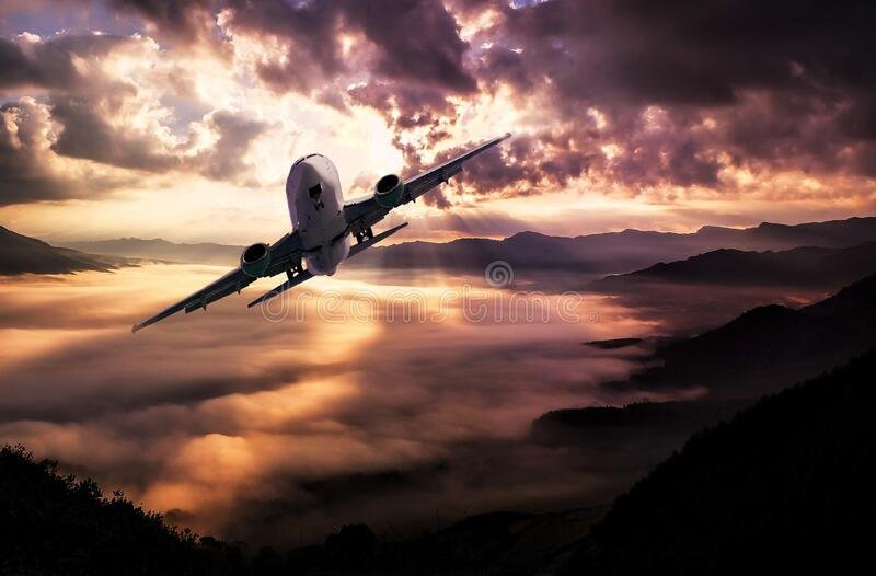 Airplane Flying Under White Clouds During Night Time Free Public Domain Cc0 Image