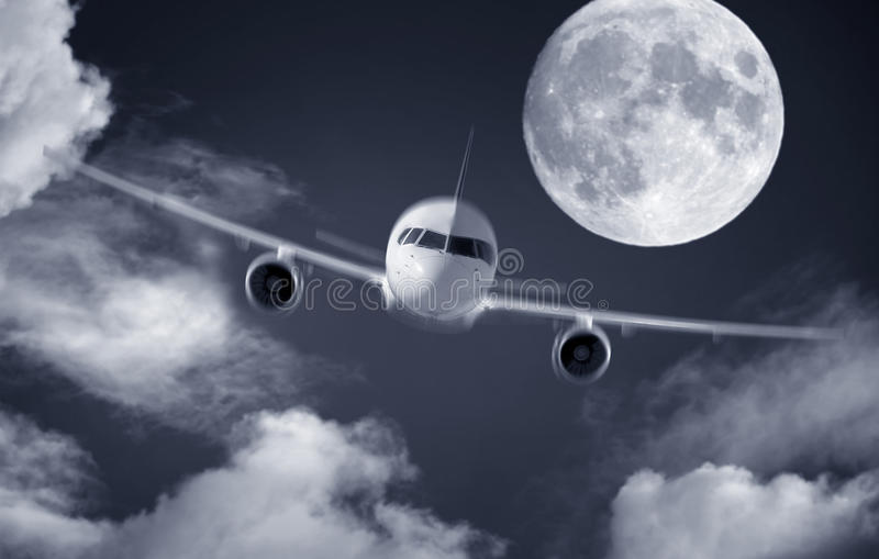 Airplane and a full moon. Photo of airplane and a full moon stock photo