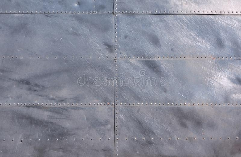 Airplane fuselage silver metal texture with rivets. royalty free stock images