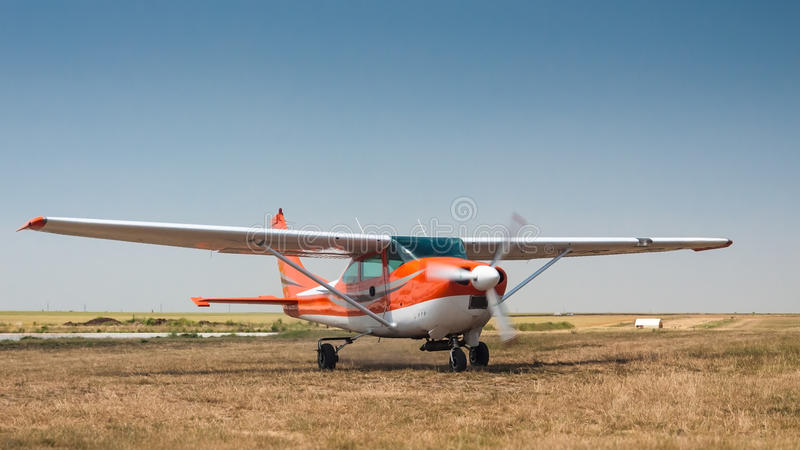 Airplane on grass airfield copy space