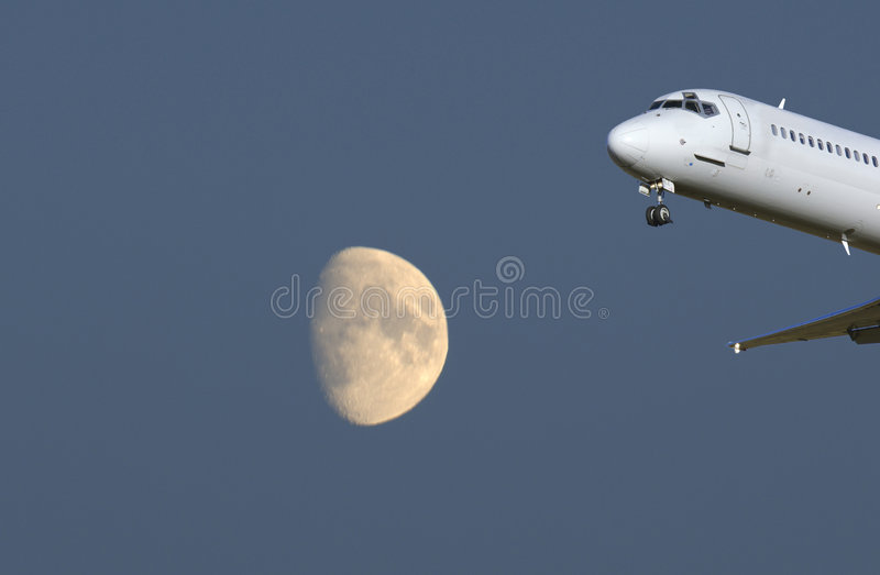 Airplane and half-moon royalty free stock photo
