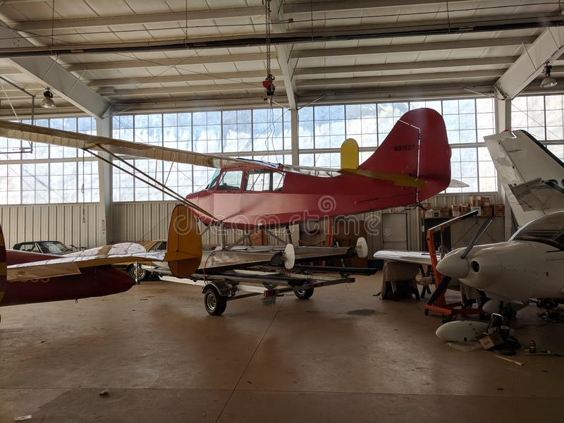 Airplane hangar. Inside of an airplane hangar with old vintage planes stock photos
