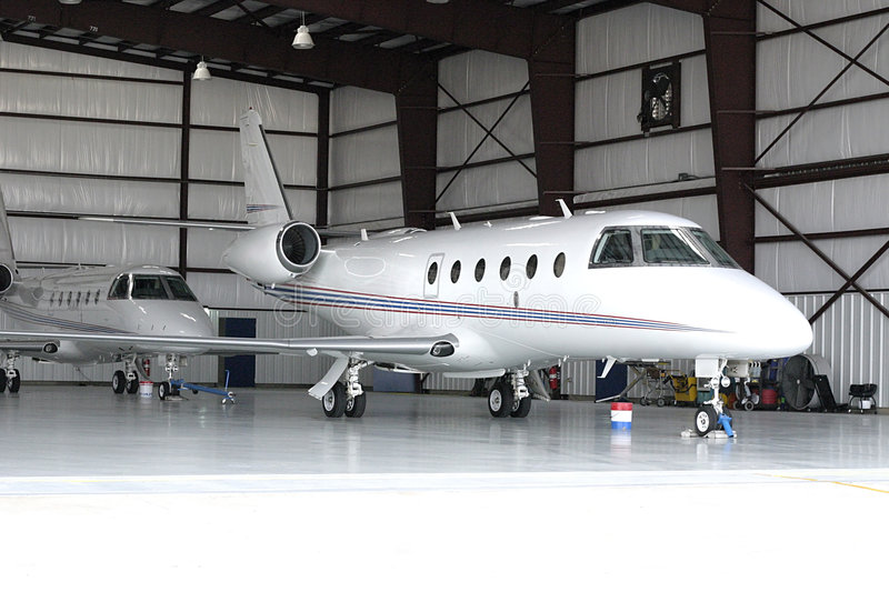 Airplane in Hanger royalty free stock photos