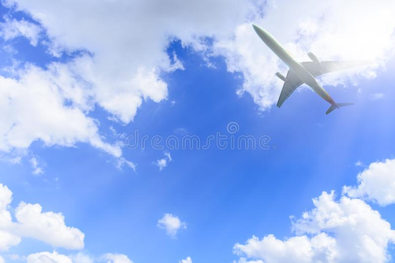 Airplane has takeoff in the blue sky background and white big cl royalty free stock images