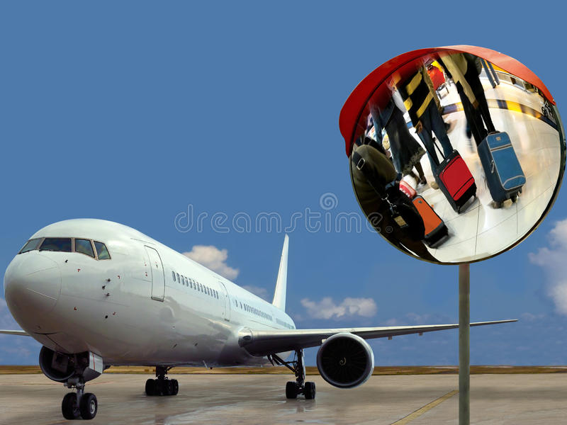 Airplane & hurry-up passengers at airport. stock images