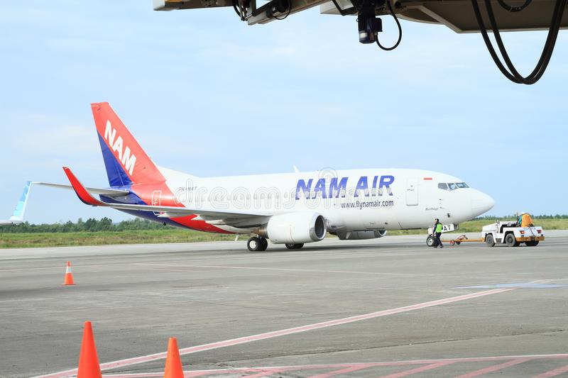 Airplane of Nam Air on airport royalty free stock image