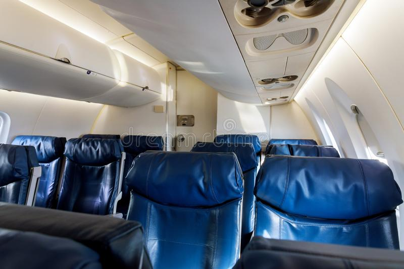 Airplane inside interior passenger airliner flying. Airplane inside interior passenger airliner of the aircraft during the flight of tourists flying, armchair stock image
