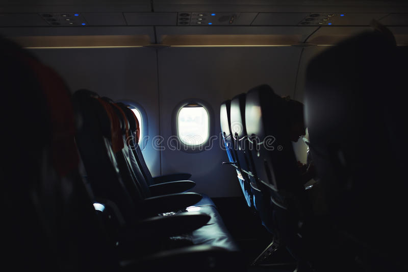 Airplane interior, empty seats and windows stock photography