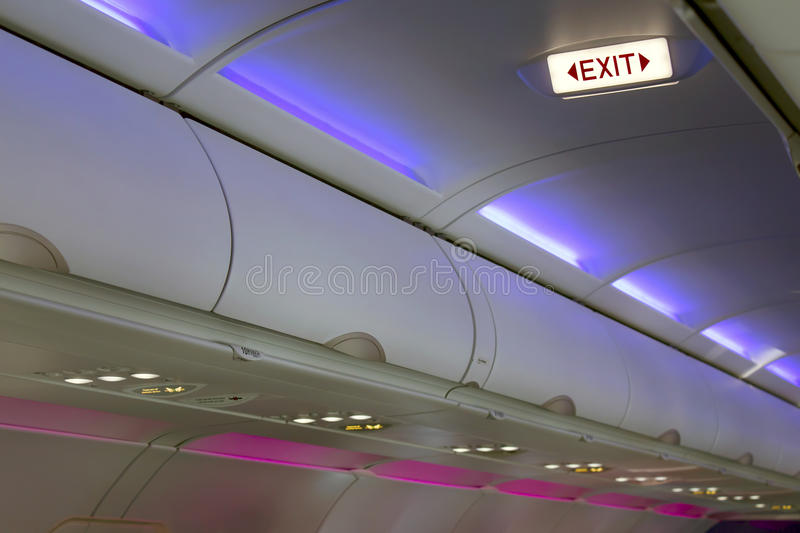 Airplane Interior Lighting And Signs Royalty Free Stock Image
