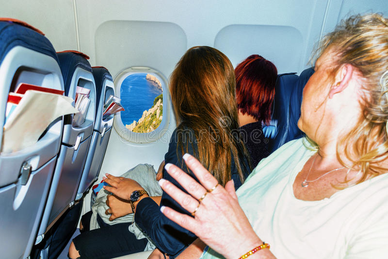Airplane interior with passengers stock images