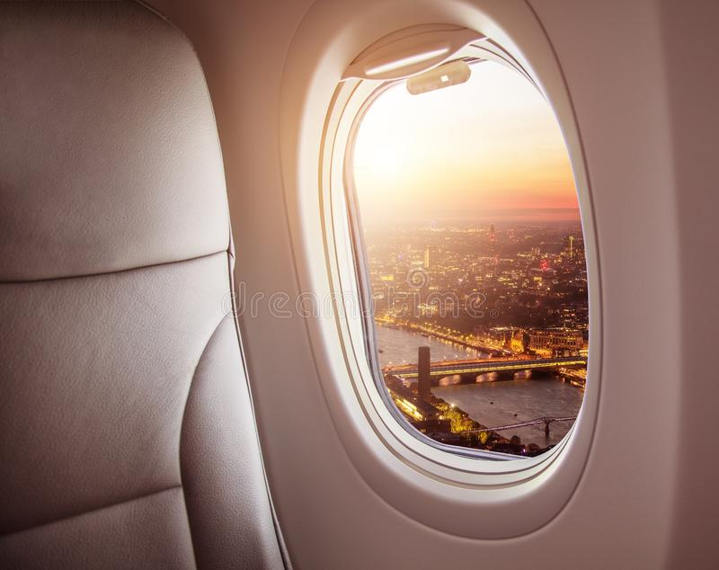 Airplane interior with window view of London city, Europe. stock photography