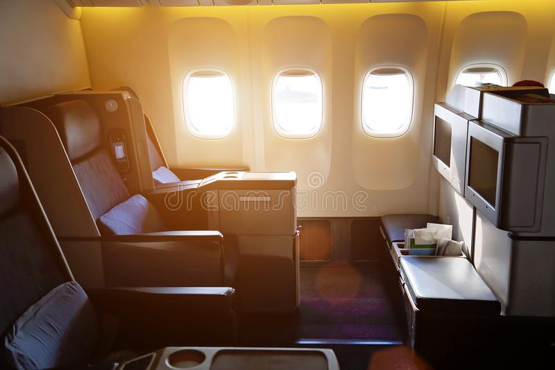 Airplane interiors, first class. Seats stock photography