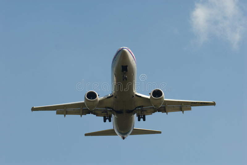 Airplane landing. Stockphoto of an airplane landing on an airfield stock photo