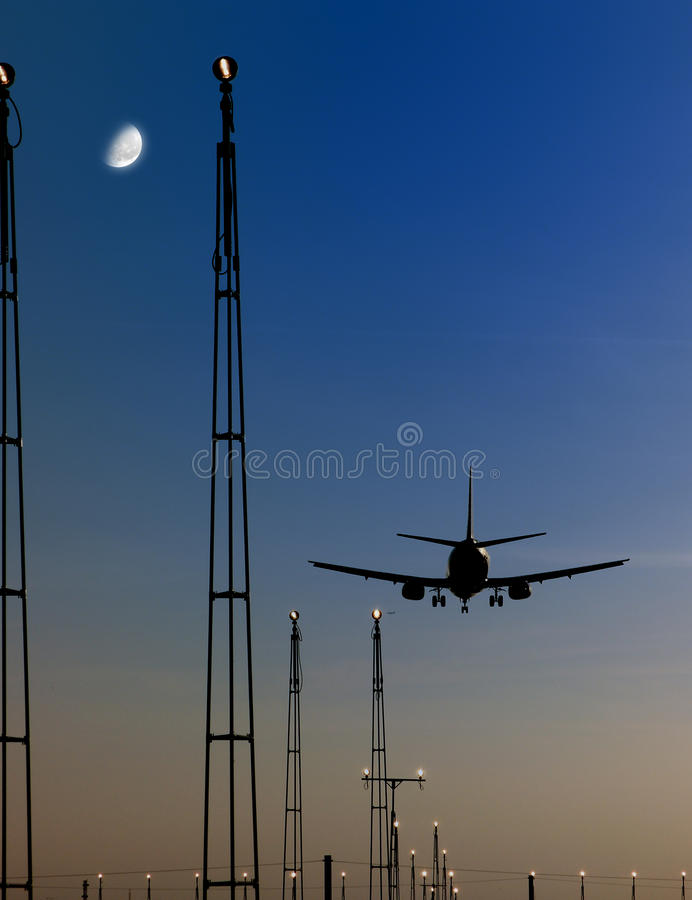 Download Airplane Landing At Airport Stock Image - Image of infrastructure, sunset: 9955743