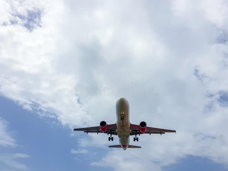 Airplane landing at Arrecife airport on the island of Lanzarote, Canary Islands. Spain Picture from below taken to the belly of. The plane off transportation royalty free stock photography