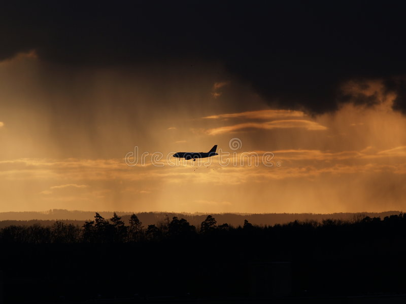 Airplane landing, dark sky royalty free stock photography
