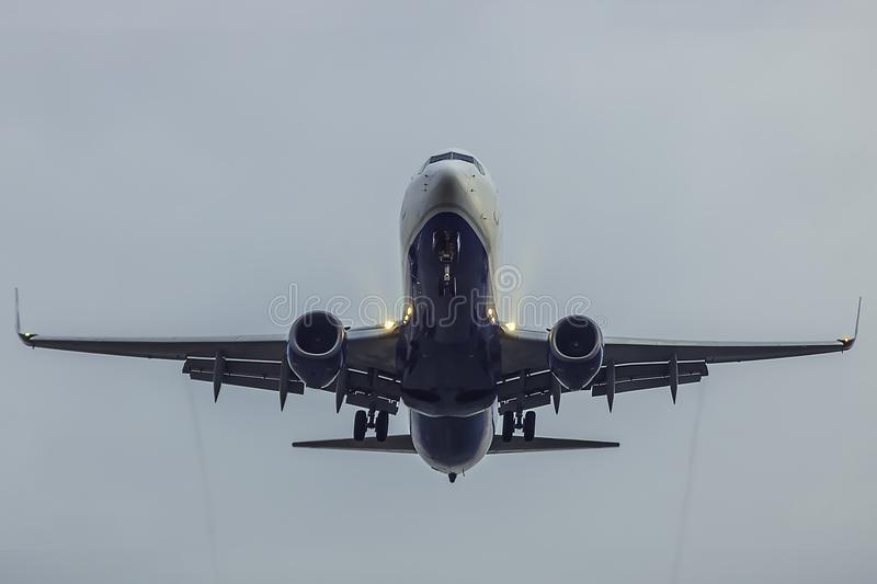 Airplane on landing with full flaps stock images