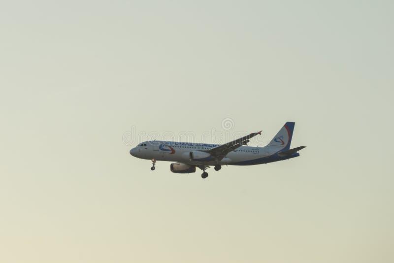 Airplane landing at Kuala Lumpur Airport royalty free stock photo