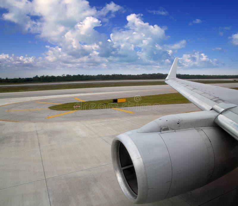 Airplane in landing runway road plane wing royalty free stock photo