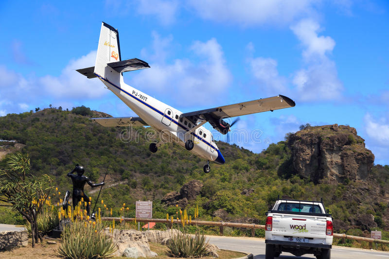 Airplane landing at St. Barth royalty free stock images