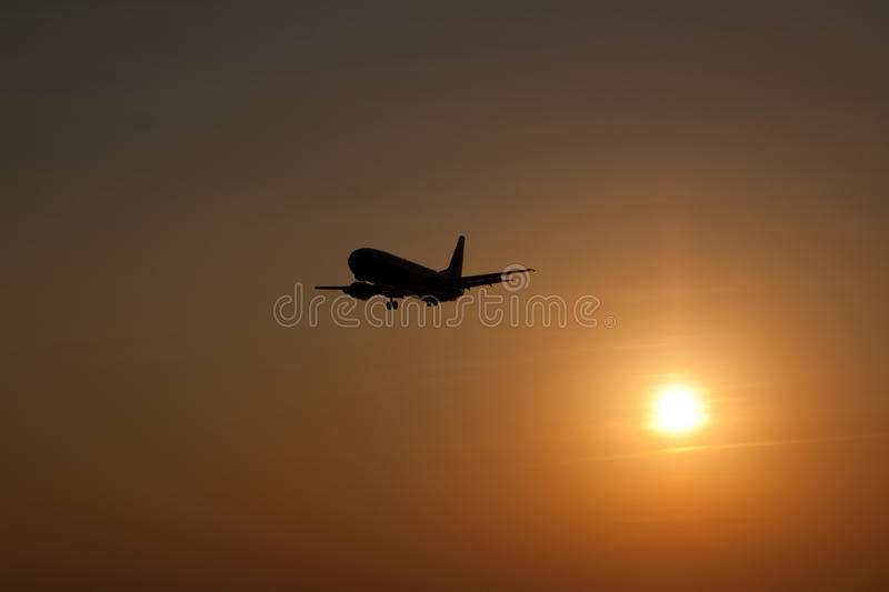 Download Airplane landing at sunset stock photo. Image of dusk - 22524836