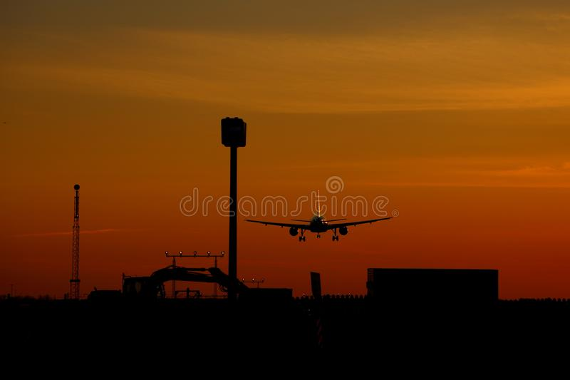 Airplane landing at sunset at Montreal-Trudeau airport, Montreal stock photo