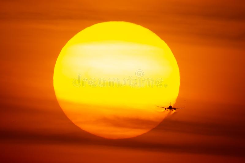Airplane landing or takeoff in the sunset with red sky in Bucharest international airport , Plain spotting royalty free stock images