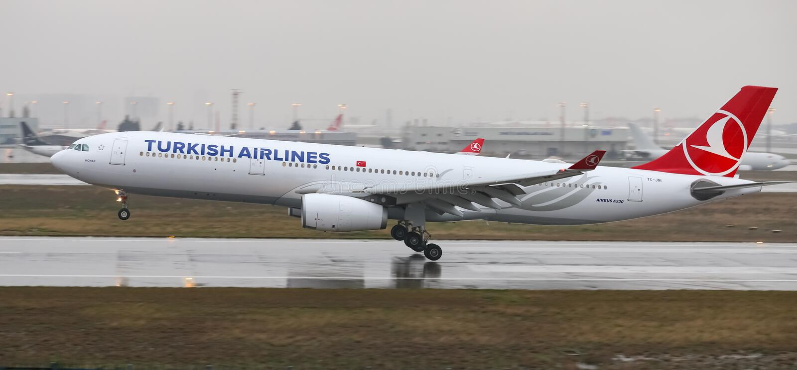 Airplane Landing to Airport. ISTANBUL, TURKEY - MARCH 04, 2018: Turkish Airlines Airbus A330-343X (CN 1160) landing to Istanbul Ataturk Airport. THY is the flag stock photography