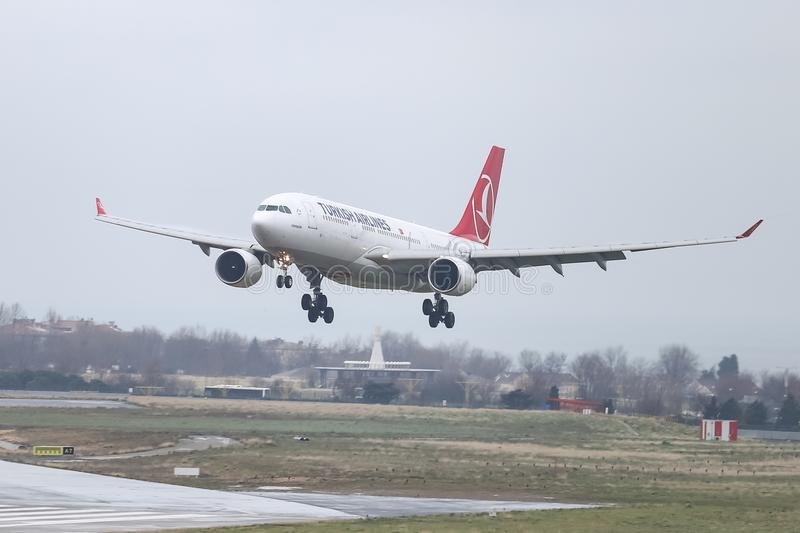 Airplane Landing to Airport. ISTANBUL, TURKEY - MARCH 04, 2018: Turkish Airlines Airbus A330-223 (CN 869) landing to Istanbul Ataturk Airport. THY is the flag stock image