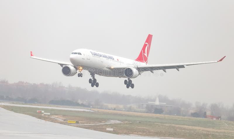 Airplane Landing to Airport. ISTANBUL, TURKEY - MARCH 04, 2018: Turkish Airlines Airbus A330-202 (CN 932) landing to Istanbul Ataturk Airport. THY is the flag stock photo