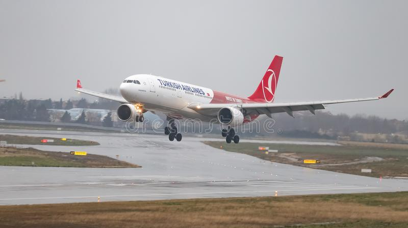 Airplane Landing to Airport. ISTANBUL, TURKEY - MARCH 04, 2018: Turkish Airlines Airbus A330-223 (CN 1118) landing to Istanbul Ataturk Airport. THY is the flag stock image