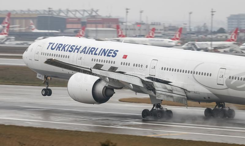 Airplane Landing to Airport. ISTANBUL, TURKEY - MARCH 04, 2018: Turkish Airlines Boeing 777-3F2ER (CN 44116) landing to Istanbul Ataturk Airport. THY is the flag stock photo