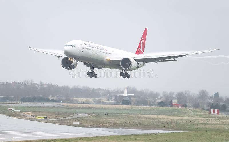 Airplane Landing to Airport. ISTANBUL, TURKEY - MARCH 04, 2018: Turkish Airlines Boeing 777-3F2ER (CN 40709) landing to Istanbul Ataturk Airport. THY is the flag stock images