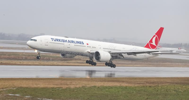 Airplane Landing to Airport. ISTANBUL, TURKEY - MARCH 04, 2018: Turkish Airlines Boeing 777-3F2ER (CN 40791) landing to Istanbul Ataturk Airport. THY is the flag royalty free stock image