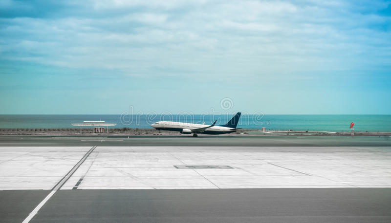 Download Airplane In Lanzarote Airport Runaway With Sea On The Background Stock Image - Image of flight, airplane: 71893339