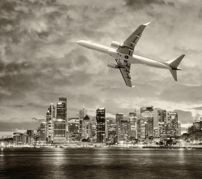 Airplane leaving Sydney. Travel concept stock photography