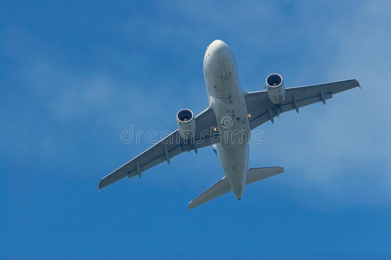 Airplane lifting off royalty free stock photography