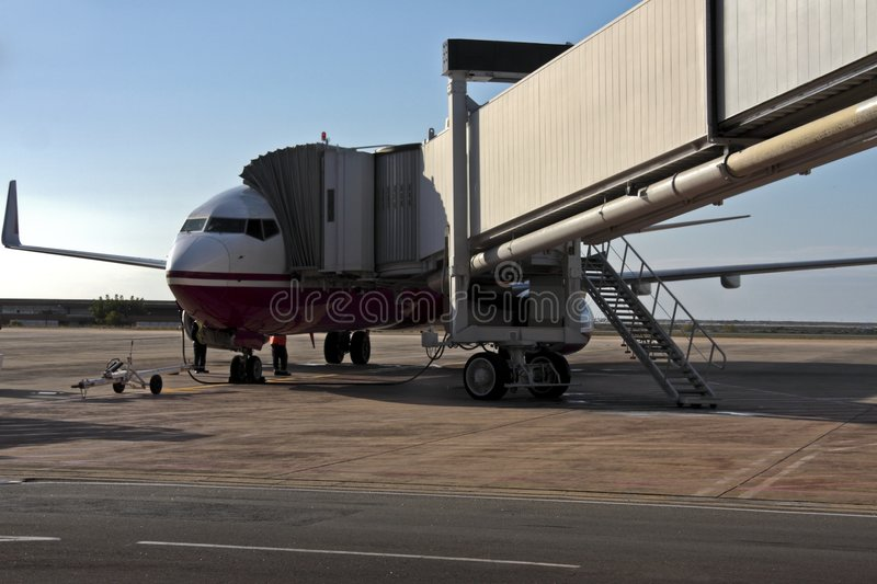 Airplane Loading Fuel And Cargo In The Airport Royalty Free Stock Photo