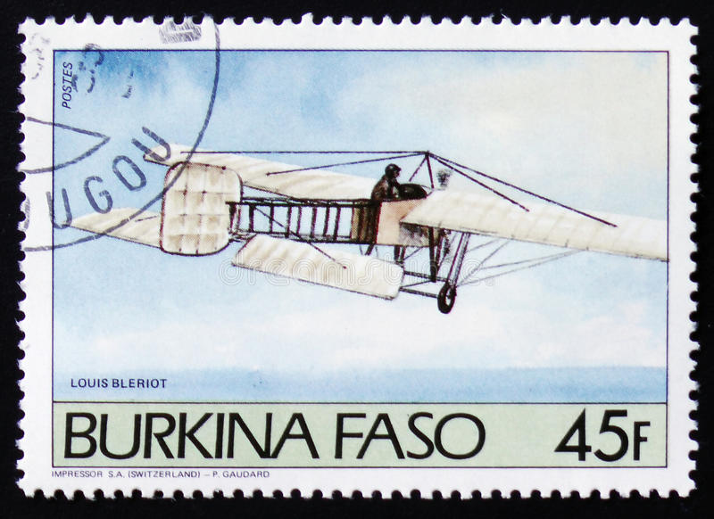 Airplane Louis Bleriot. MOSCOW, RUSSIA - FEBRUARY 12, 2017: A post stamp printed in Burkina Faso shows airplane Louis Bleriot stock photo